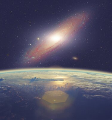 Canvastavlor Soluppgång över jorden med stor Andromedagalaxen.
