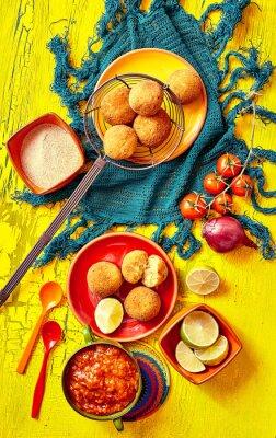 Canvastavlor Stekta bolhinos och garnering i skålar och tallrikar