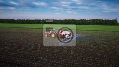 Canvastavlor Traktor besprutning fält på våren