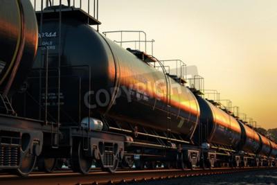 Canvastavlor Transport tankvagnar med olja under solnedgången.