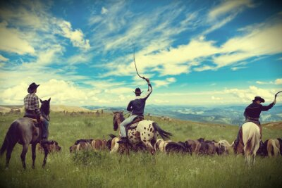 Canvastavlor Tre cowboys kör flock hästar, toning, vinjettering