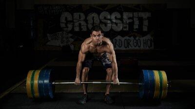 Canvastavlor Tyngdlyftning. Sport. Uthållighet. Muskulös överkropp idrottsman lyfta tunga skivstång i gymmet.