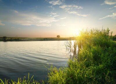 Canvastavlor Tyst flod vid solnedgången