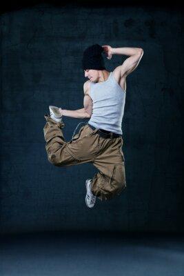 Canvastavlor Ung hip-hop dansare hoppning