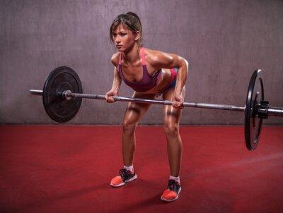 Canvastavlor Ung kvinna i träningspass