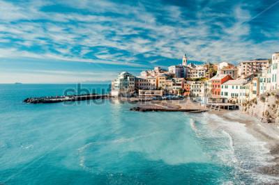 Canvastavlor View of Bogliasco. Bogliasco is a ancient fishing village in Italy, Genoa, Liguria. Mediterranean Sea, sandy beach and architecture of Bogliasco town. Cloudy blue sky sunny day idyllic scenery, winter