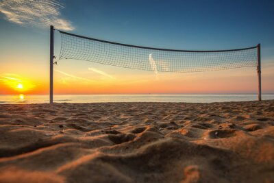 Canvastavlor Volleybollnät och soluppgång på stranden