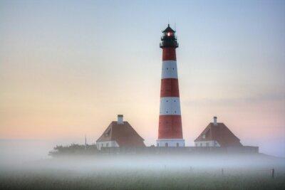 Canvastavlor Westerhever fyr i dimman Sunrise