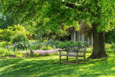 Canvastavlor wooden bench at flower garden park