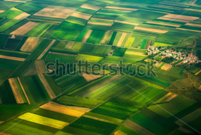 Fototapet aerial photo from a plane, top view, field roads and city
