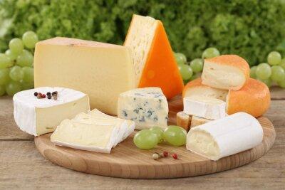 Fototapet Auswahl en Käse wie Camembert, Bergkäse und Schweizer Käse
