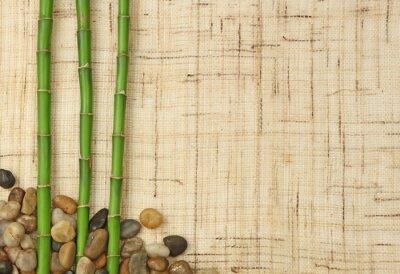Fototapet bambou et Cailloux sur fond de toile de jute
