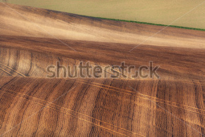 Fototapet Beautiful concept landscape with striped fields of South Moravia at sunset, abstract background