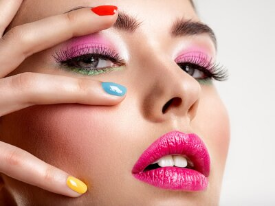 Fototapet Beautiful fashion woman with a colored nails. Attractive white girl with multicolor manicure.