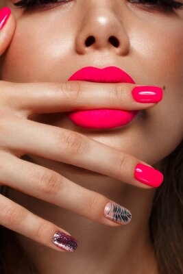 Fototapet Beautiful young woman with bright makeup and neon pink nails. Beauty face. Photo taken in the studio