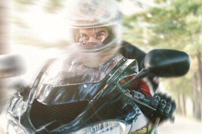 Fototapet Biker på väg rida snabbt