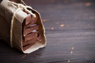Fototapet Bitar av choklad packade