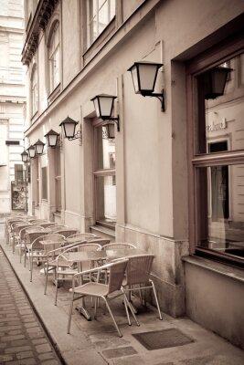 Fototapet Bord och stolar i ett café