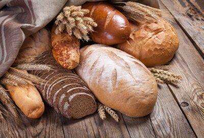 Fototapet Bröd och öron på en gammal bord