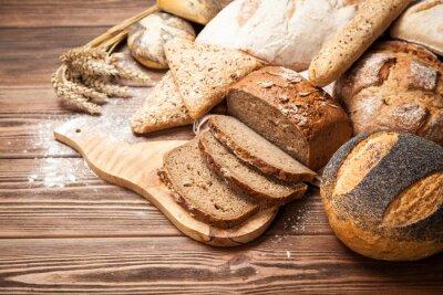 Fototapet Bröd sortiment på träytan