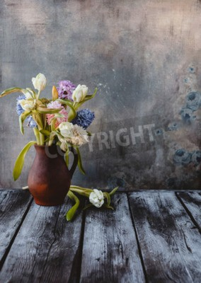 Fototapet Ceramic jug with spring flowers on wooden table