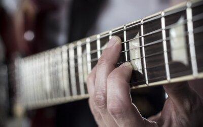 Fototapet Dedos sobre diapason de guitarra