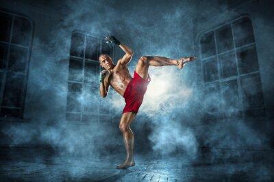 Fototapet Den unge mannen kickboxning