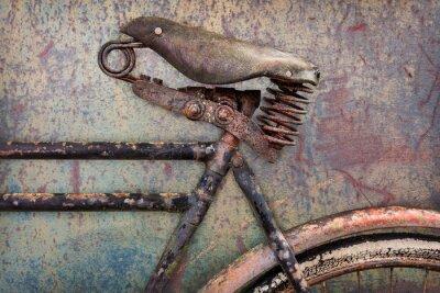 Fototapet Detalj av en rostig gammal cykel med skinn