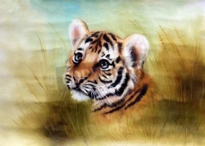 Fototapet En vacker airbrushmålning av en förtjusande baby tiger huvud ser ut från ett grönt gräs omgivningar