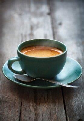 Fototapet Espresso kaffe i en grön kopp, selektiv inriktning