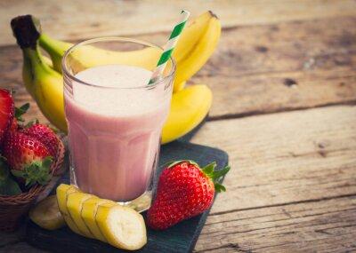 Fototapet Färska jordgubbar och banan smoothie