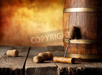 Fototapet Fat med vin och korkskruv på ett träbord