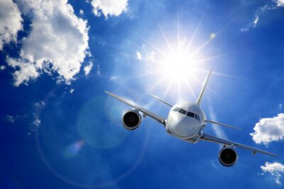 Fototapet Flugzeug i Sonne und Wolken