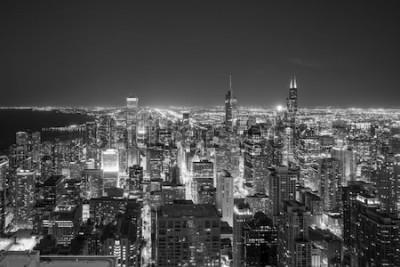 Fototapet Flygfoto över Chicago i stadens centrum horisont på solnedgången från högt ovan.