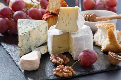 Fototapet formade ostar och snacks på tavlan