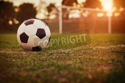 Fototapet Fotboll i solnedgången