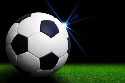 Fototapet Fotboll på grön stadion