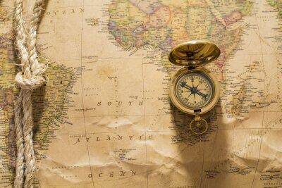 Fototapet gammal kompass och rep på vintagekarta