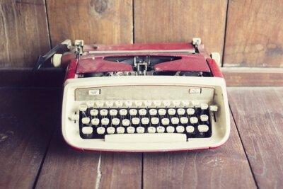 Fototapet Gammal stil skrivmaskin på ett trägolv