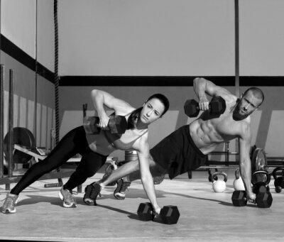 Fototapet Gym man och kvinna push-up styrka pushup