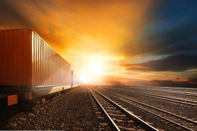 Fototapet industrin container tåg som trafikerar järnvägen spår mot beau