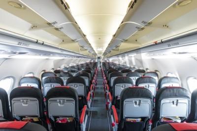 Fototapet Inre modernt flygplan. Svarta och röda säten inuti flygplan. Symmetrisk försvinnande sätesrad inne luftfarten. Ekonomiklass av flyg. Utrustning för att resa. Tom belysta planet.