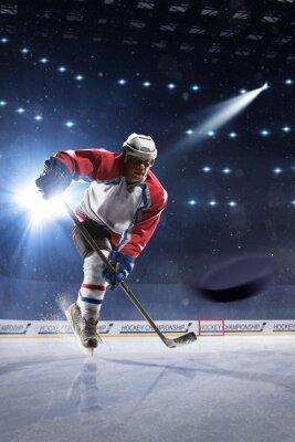 Fototapet Ishockeyspelare på isen arenan