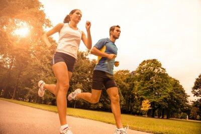 Fototapet Jogga tillsammans - sport ungt par