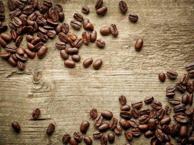 Fototapet Kaffebönor på träbord