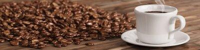 Fototapet Kopp kaffe med många kaffebönor