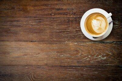 Fototapet latte kaffe på trä med utrymme.