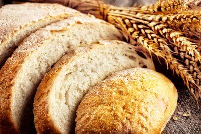 Fototapet Limpa skivat vitt bröd med öron vete