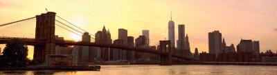 Fototapet Manhattan horisont panorama med Brooklyn Bridge i solnedgången, New York, USA