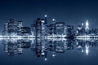 Fototapet Manhattan på natten med reflektioner kring Harlem river